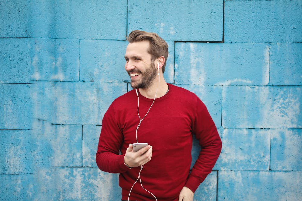 The Best Podcasts To Listen To When Travelling