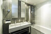neat and trim bathroom with tub in Cannes Festival V Apartment luxury home