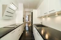 neat kitchen cabinets in Cannes Carnot Apartment 2BR luxury home