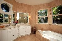 cool bathroom with tub in New Providence Serendip Cove luxury vacation rental