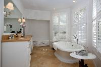 cool freestanding bathtub in New Providence Serendip Cove luxury vacation rental
