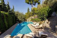 cool poolside furniture of Cannes Villa Les Terrasses luxury apartment