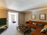 cozy sitting room of Cannes Villa L'Autre Temps luxury apartment