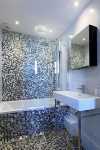 neat bathroom with tub in Cannes Apartment Starlette I luxury home