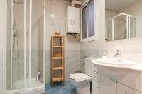 invigorating shower in Barcelona - Paseo de Gracia 4BR luxury apartment
