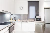 modern kitchen appliances in Barcelona - Modern Ramblas 2BR luxury apartment