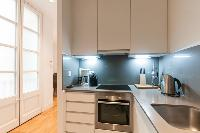 delightful kitchen of Barcelona - Modern Ramblas 2BR luxury apartment