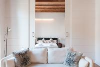 plush sofa in Barcelona - Modern Ramblas 2BR luxury apartment