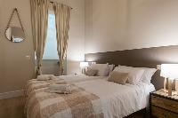 clean and crisp bedroom linens in Barcelona - Sant Antoni Market 3BR luxury apartment