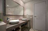 cool double-sink bathroom vanity in Barcelona - Sant Antoni Market 3BR luxury apartment
