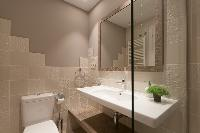 spic-and-span toilet and bath in Barcelona - Sant Antoni Market 3BR luxury apartment