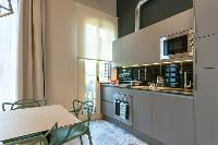 neat modern kitchen of Barcelona - Sant Antoni Market 3BR luxury apartment