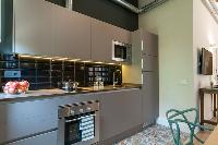 nice modern kitchen of Barcelona - Sant Antoni Market 3BR luxury apartment
