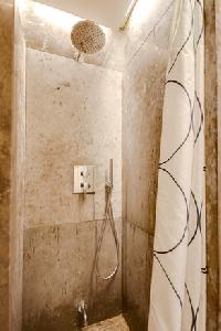 invigorating shower in Lisbon - O Tejo luxury apartment and vacation rental