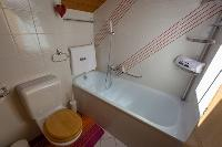 cool bathtub in Luxury Apartment Les Frères holiday home and vacation rental