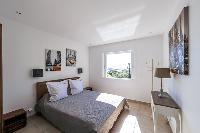 nicely furnished bedroom of Corsica - Cala Rossa luxury apartment