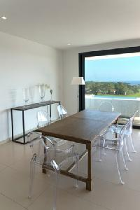 awesome table with ghost chairs in Corsica - Palombaggia luxury apartment