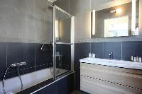 fresh and clean bathroom with tub in Corsica - Pietra luxury apartment