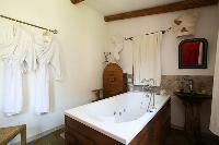 neat bathroom with tub in Corsica - Villa Authentique luxury apartment