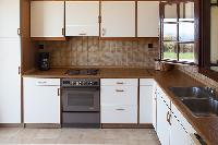 modern kitchen of Kefalonia Absolute Ai-Helis Villas Serenata luxury holiday home, vacation rental