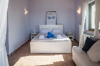 clean bedroom linens in Kefalonia Absolute Ai-Helis Armonia luxury holiday home, vacation rental