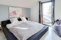 awesome bedroom with a view at French Alps - L'Hermine luxury apartment