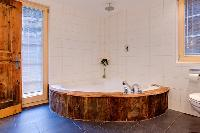 fun whirlpool bathtub in Chalet Heidi luxury apartment, holiday home, vacation rental
