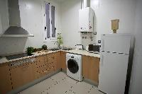 modern kitchen appliances in Barcelona - Platinum luxury apartment