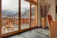 cool wooden deck of luxury apartment Penthouse Chalet Zora holiday home, vacation rental