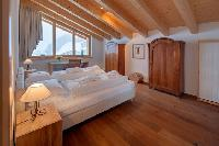 pristine bed sheets in luxury apartment Penthouse Chalet Zora holiday home, vacation rental