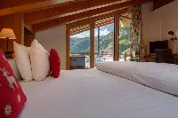 fresh bedroom linens in Chalet Zermatt Lodge luxury apartment, holiday home, vacation rental