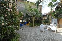 cool patio and garden of Villa San Giulio luxury apartment