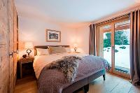 pristine bedroom linens in Chalet Delormes luxury apartment, holiday home, vacation rental