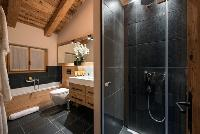 cool shower and bathtub in Chalet Sirocco luxury apartment, holiday home, vacation rental