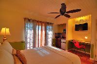 crisp bedroom linens in Bahamas - Villa Allamanda Queen Studio B luxury apartment
