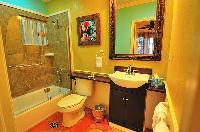 cool bathroom with tub in Bahamas - Villa Allamanda Queen Studio B luxury apartment
