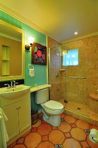 neat and trim toilet and bath in Bahamas - Villa Allamanda Queen Studio B luxury apartment