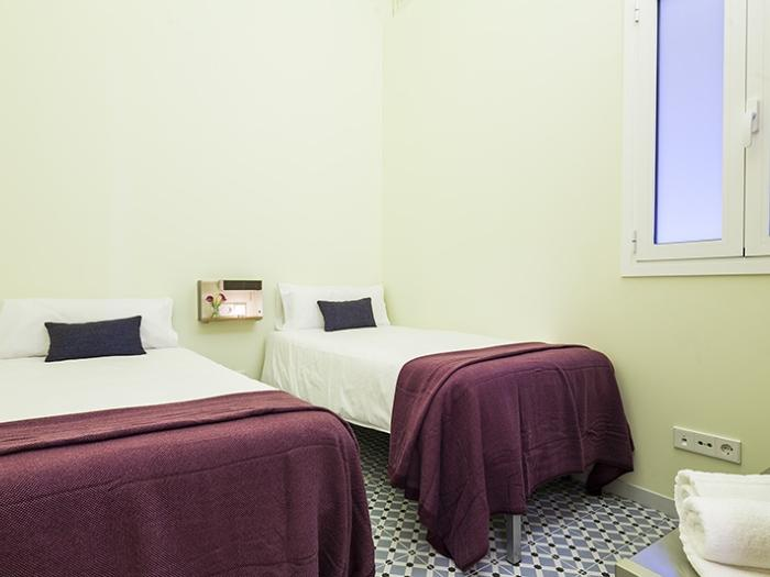 fresh and clean bedroom linens in Barcelona Eixample - Pau Claris Luxury Apartment 1