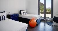 clean bed sheets in Mykonos Villa Estilo luxury holiday home and vacation rental