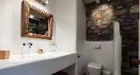 clean toilet and bath in Mykonos Villa Light Pearl luxury holiday home and vacation rental