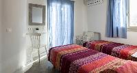 clean bedroom linens in Mykonos Villa Light Pearl luxury holiday home and vacation rental