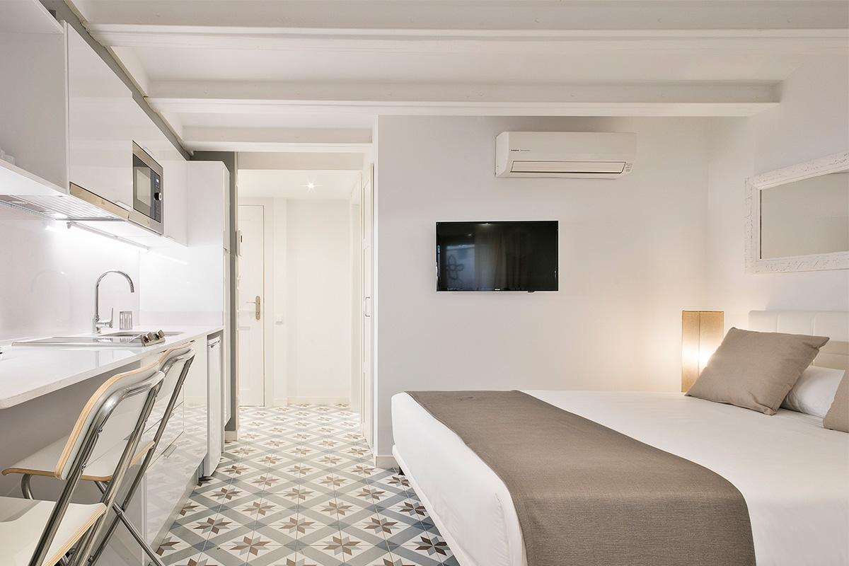 clean and crisp bedroom linens in Barcelona - Holy Family Tiny Studio 1 luxury apartment with balcon