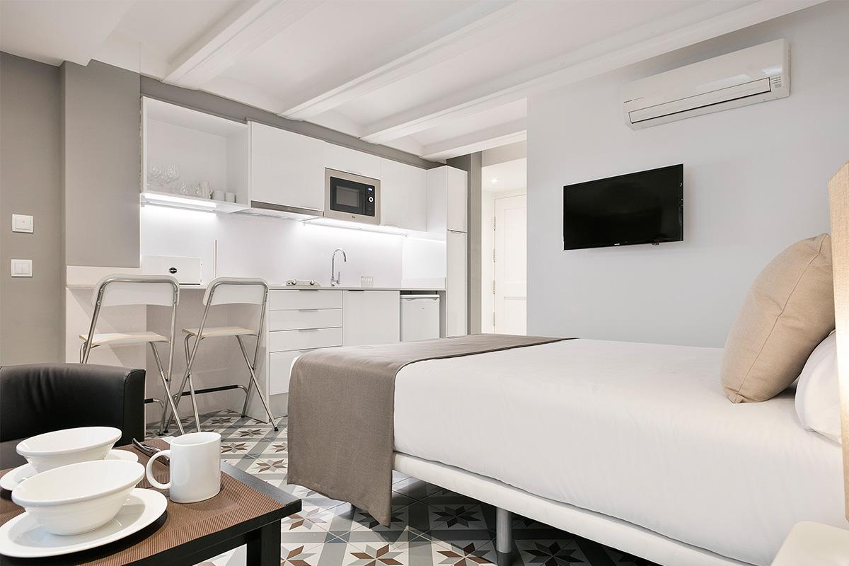 crisp and clean bedroom linens in Barcelona - Holy Family Tiny Studio 1 luxury apartment with balcon