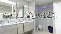 clean toilet and bath in Saint Barth Villa Au Coeur Du Rocher luxury holiday home, vacation rental