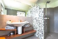 clean toilet and bath in Saint Barth Villa Datcha luxury holiday home, vacation rental