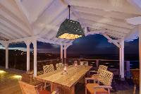 cool dining room of Saint Barth Villa Lagon Bleu luxury holiday home, vacation rental