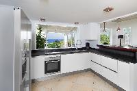 cool modern kitchen of Saint Barth Villa Lagon Bleu luxury holiday home, vacation rental