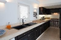 cool modern kitchen of Saint Barth Villa Gouverneur View luxury holiday home, vacation rental