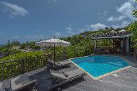 cool poolside deck of Saint Barth Villa Lagon Jaune Estate luxury holiday home, vacation rental