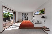 cool bedroom with balcony at Saint Barth Villa Apache luxury holiday home, vacation rental